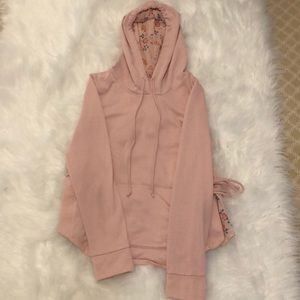 Cute pink hoodie with floral accents! 🌸